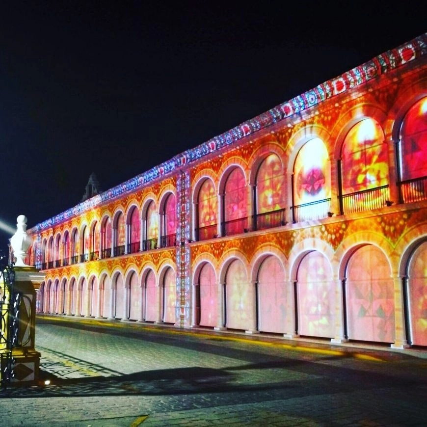 "Destination Addict - The spectacular film ""A History of the Yucatan"" projected right onto the front of the library, Campeche, Mexico"