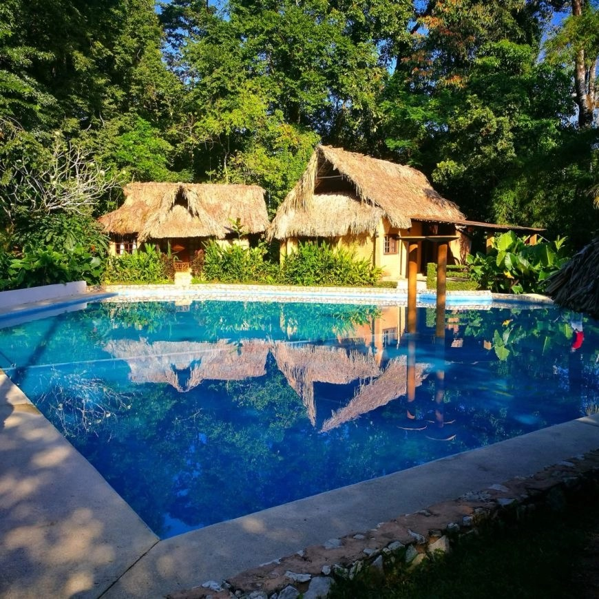 Destination Addict - Jungle side pool at Mayabell Cabanas near the ruins of Palenque, Mexico