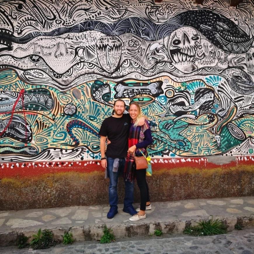 Destination Addict - Infront of some street art in San Cristobal De Las Casas, Mexico