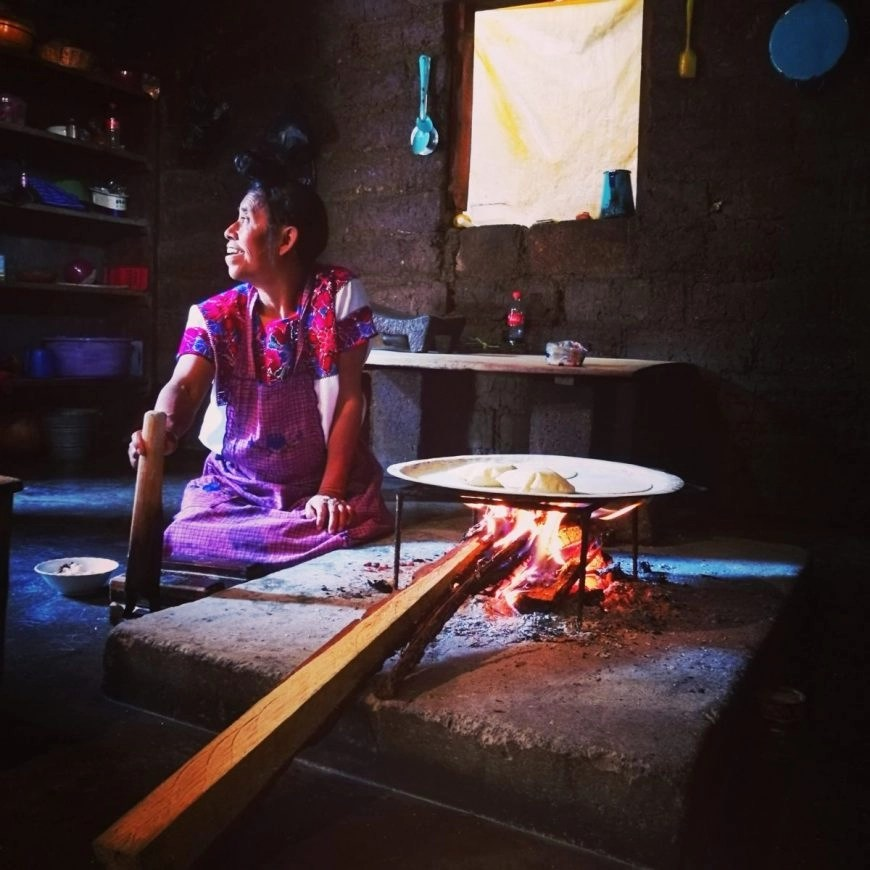 What to do in San Cristobal de las Casas - A Totzil lady making us some freshly made Tortias at her home in nearby Zinacantan, Mexico