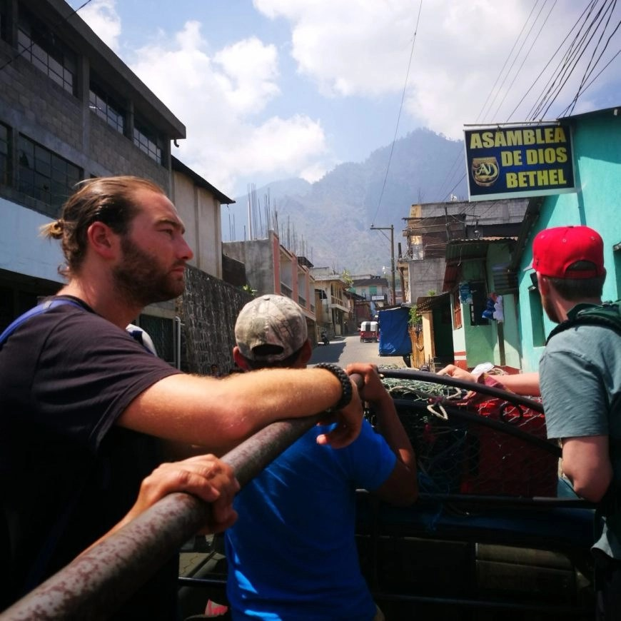 Destination Addict - Riding in the back of a pick up truck from the village of Santa Clara to San Marcos, Lake Atitlan, Guatemala