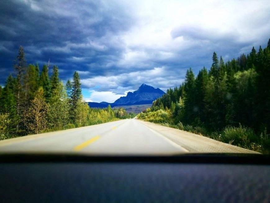Destination Addict - Driving along Highway 16 toward the Rockies