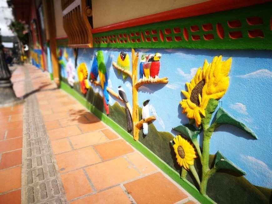 Destination Addict - So much colour & details in the houses of Guatape, Colombia