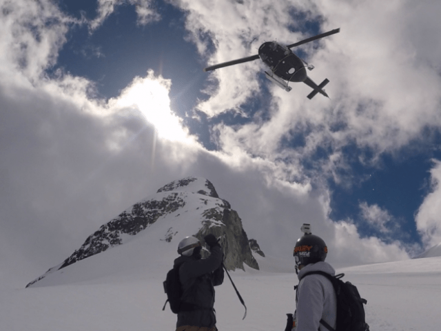 Chopper flying back over us after drop off - Whistler heli skiing