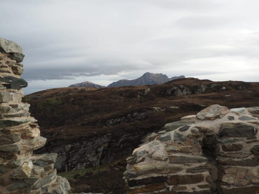 Looking out at the surrounding mountains from Varrich Castle, NC500 – An Epic Itinerary For Scotland's North Coast - Destination Addict