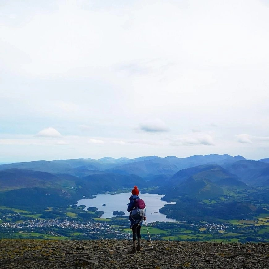Taking in the views of Derwent water from Skiddaw Little Man - Lake District Three Peaks Challenge