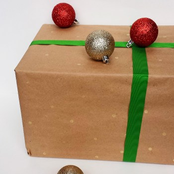 Make Your Own Wrapping Paper with Brown Paper, Hole Reinforcers, and Gold Markers
