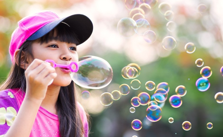 little-girl-dressed-in-pink-blowing-soap-bubbles-picture