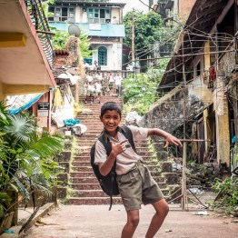 School is finished, happy schoolboy in Panjim