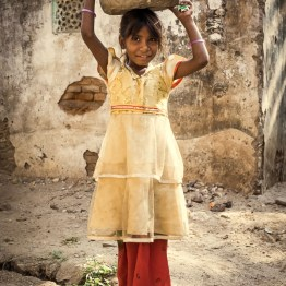 Girl with water basket on head