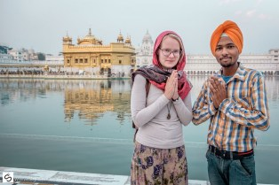 Elize and a young Sikh greet at the Golden Temple