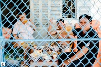 Vintage drinking men behind the gate