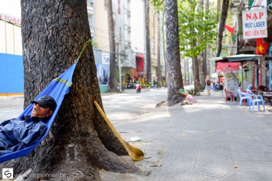 Having a nap on the street, spot the sign!