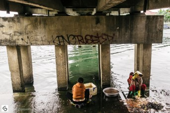 Cleaning fish under the bridge