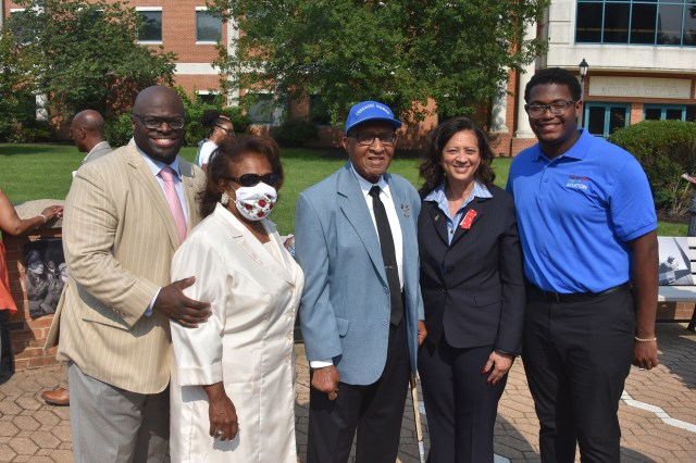 University President Tony Allen, Dr. Wilma Mishoe, Tuskegee Airman Nathan Thomas, Dr. Joi Spraggins of Legacy Bridges STEM Academy, and Aviation freshman Preston Stanberry pose for a group shot. Stanberry received a $1,000 scholarship from the Legacy Academy presented by Dr. Spraggins during the Tuskegee Airmen event.