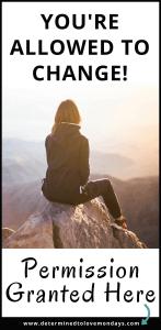 Women sitting on mountain looking into sunset