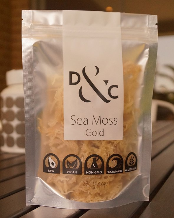sea-moss-gold-by-detox-and-cure-in-a-125g-bag-on-a-timber-table