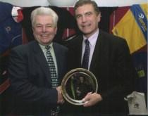 Gwyn Pierce receives his Coach of the Tear award from Trevor Bro