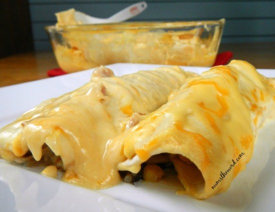 Preparing freezer meals for a month on a budget? Be sure to include this Black Beans & Rice Chicken Enchiladas recipe.