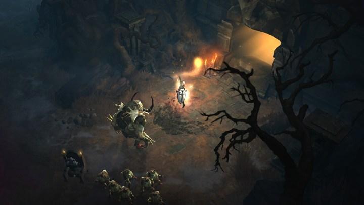 Diablo 3: Crociato fuori da un dungeon, accerchiato da un gruppo di non morti