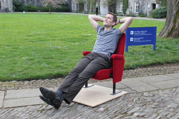 Will Carrodus stretching in enjoyment in a Barn Cinema seat. Courtesy of  Jim Whittle