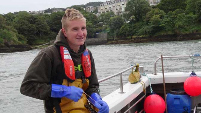Ben Bengey young fisherman on board