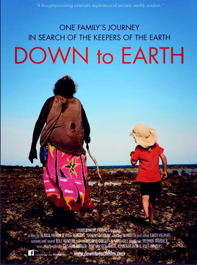 down to earth documentary poster - a woman and a child are walking away over a barren field
