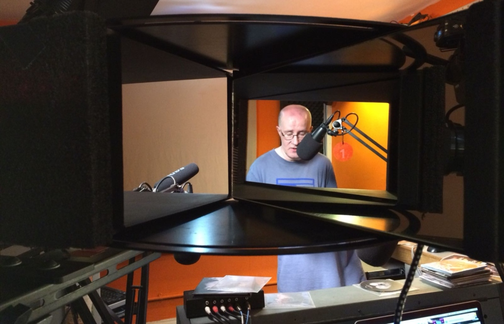 This is Phonic, documentary using Eye Direct and radio prsenter seen through a screen while being filmed presenting Phonic FM