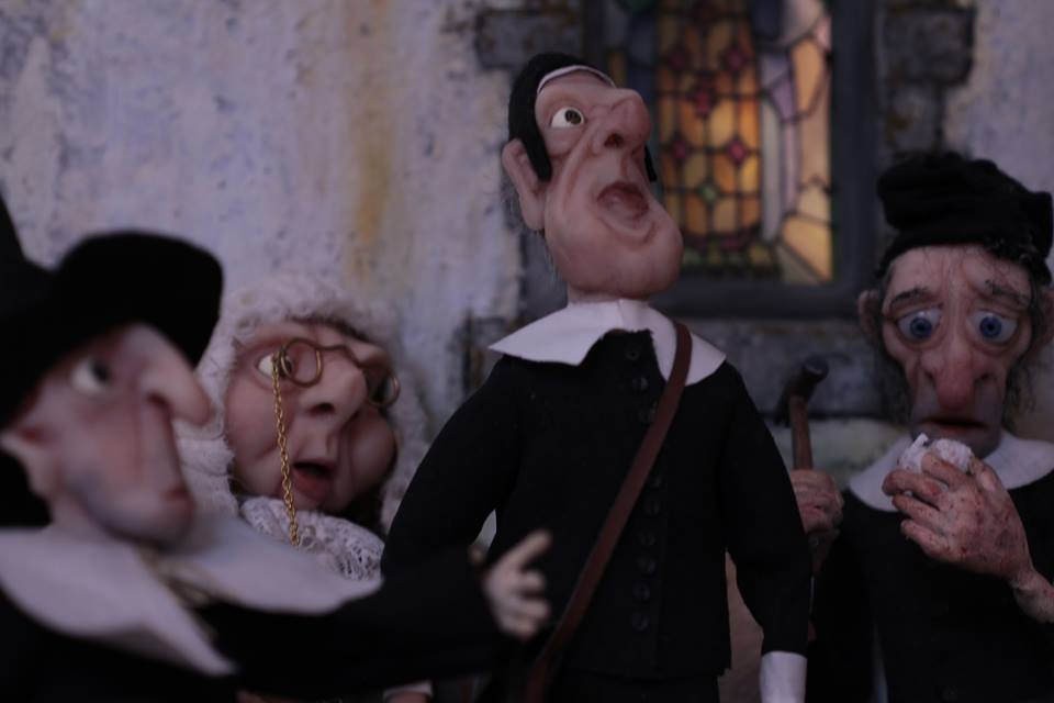 The Legend of Jan Tregeagle still: puppet Puritans gather, dressed in black with white collars
