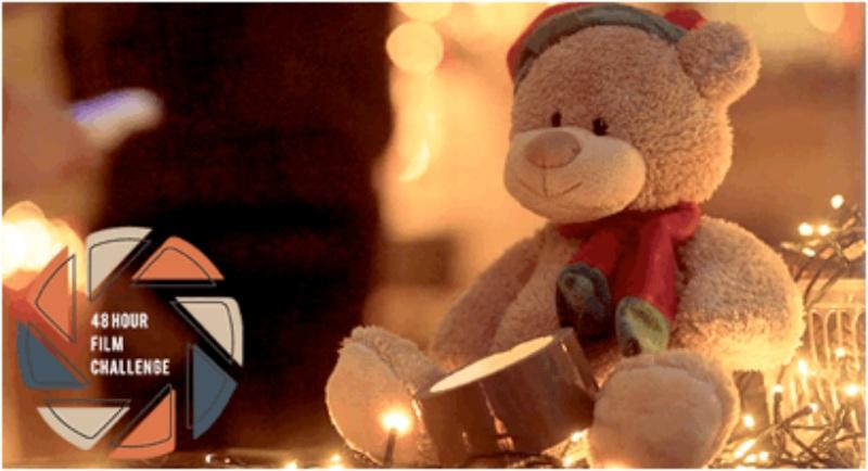 a teddy bear in warm christmas light