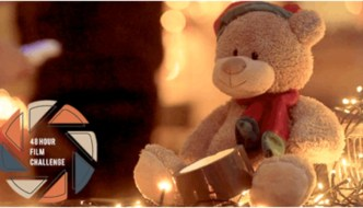 a teddy bear in warm christmas light