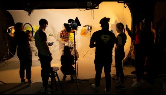 a group of people on a film set in shadow