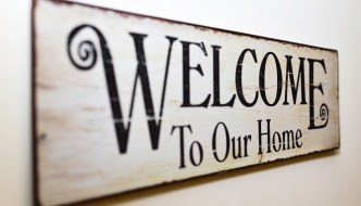 a welcome to our home sighn