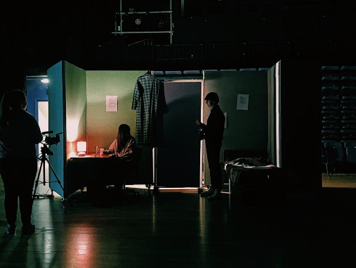 a picture of being on set in a dark shoot