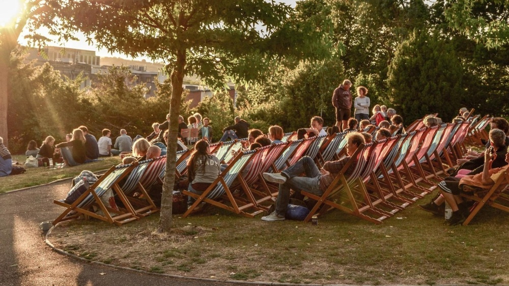 people siting on deck chair in Northernhay park Exeter
