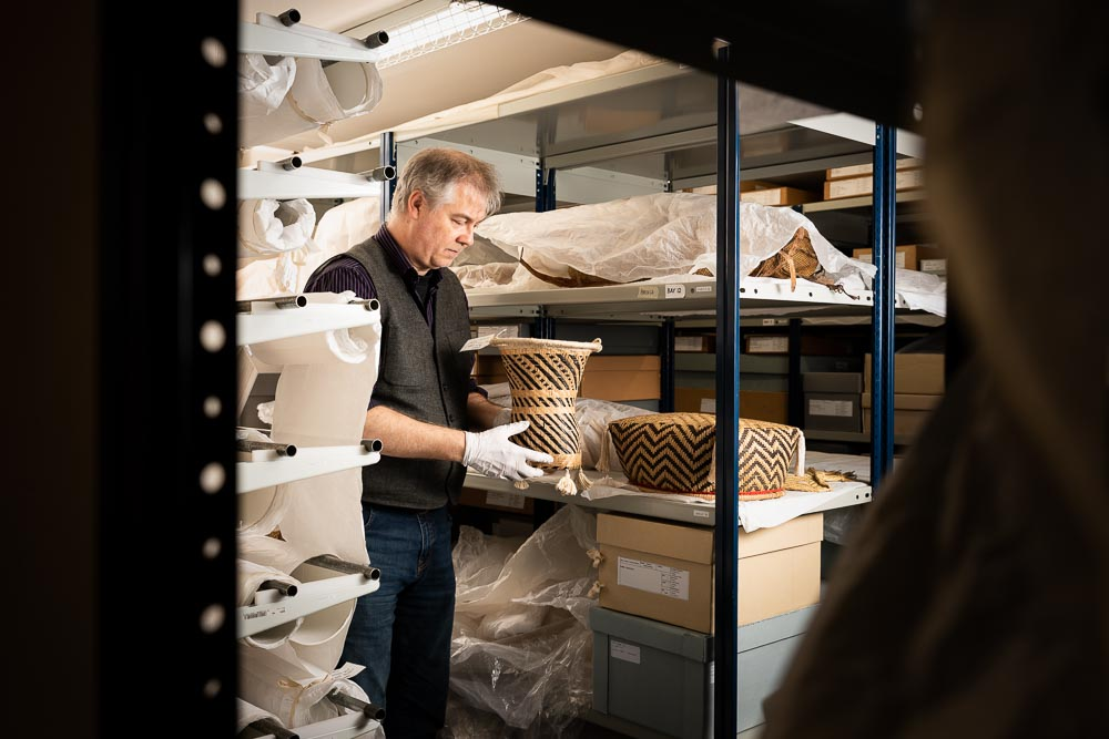 Inside the Museum still of a man in the archives of Exeter RAMM
