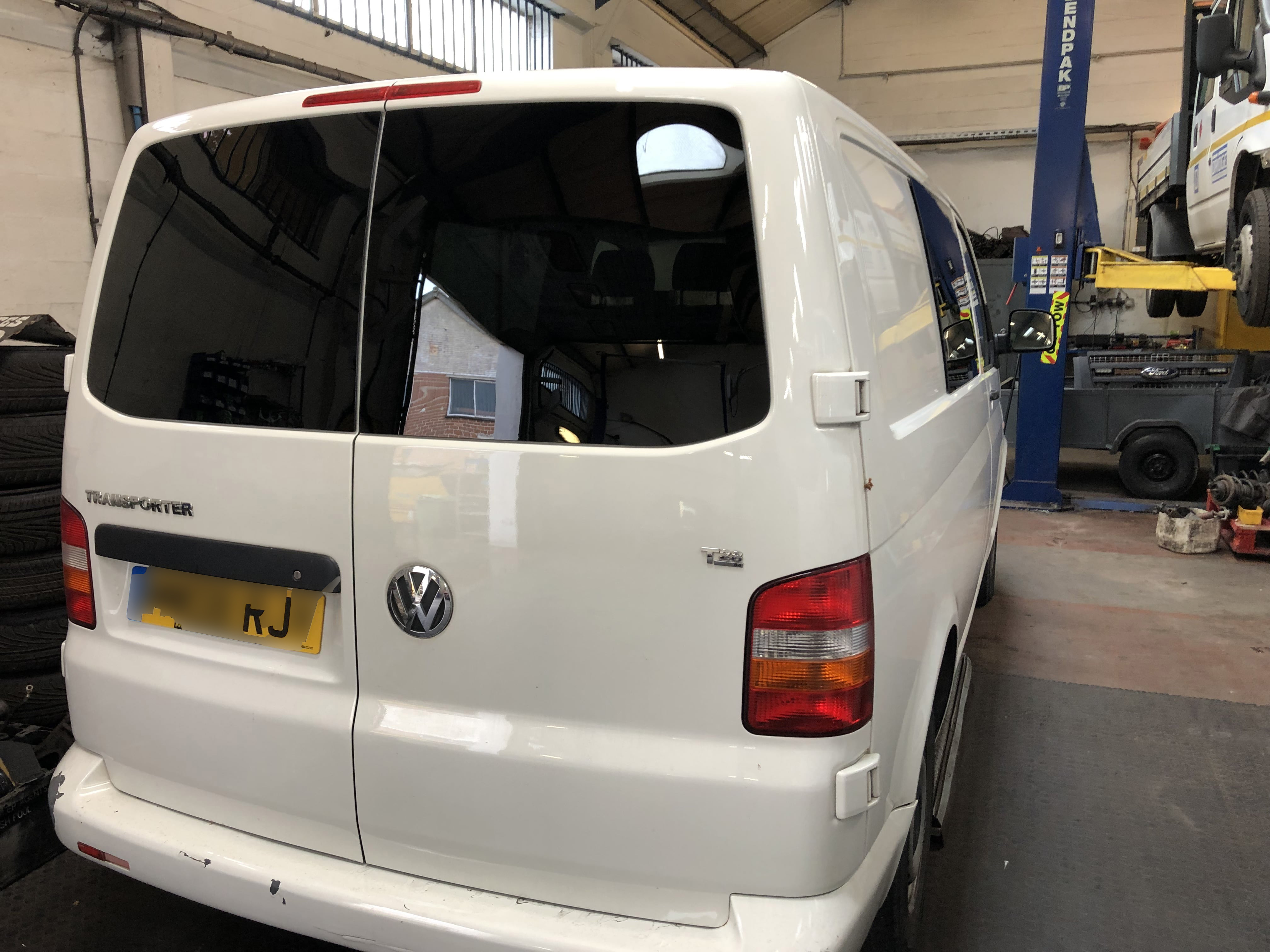 VW T5 van conversion with privacy windows.