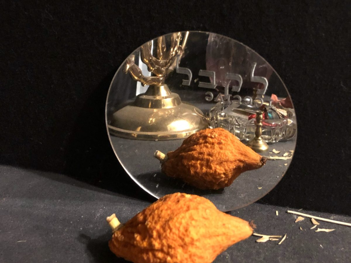 "Dried etrog with mirror that has word ""receive"" etched into it"