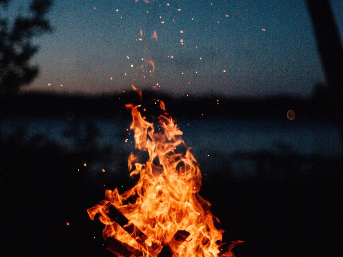 Roaring bonfire, with fading light on the horizon
