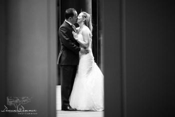 Bridal-Couple-kissing-photo-between-pillars