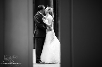Bridal-Couple-kissing-photo-between-pillars