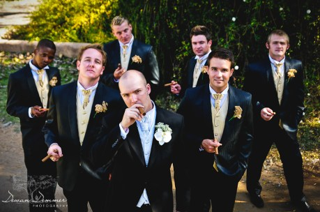Groom and the groomsmen enjoy a cigar