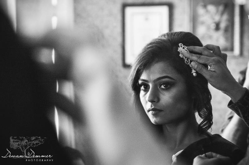 attaching hairpiece in brides hair