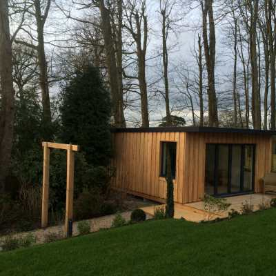 Garden room with woodland backdrop, Littlewood, Sussex