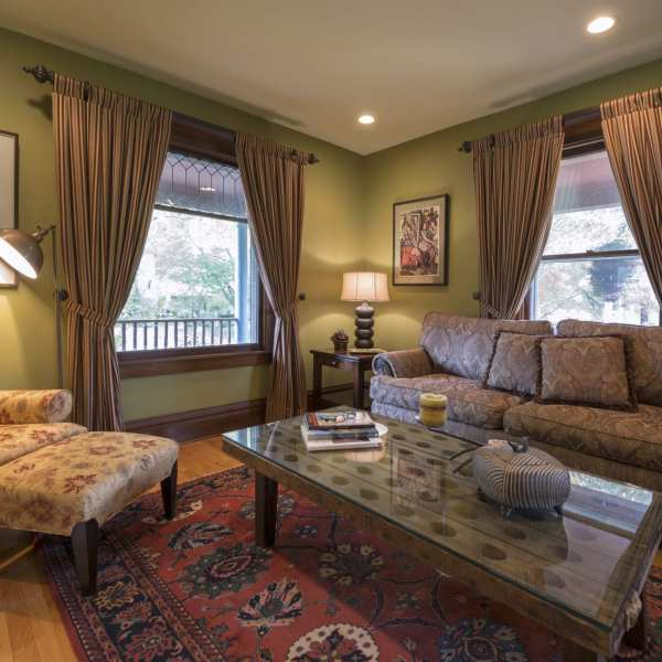 Custom Window Treatments complete the look of the traditional Living Room.