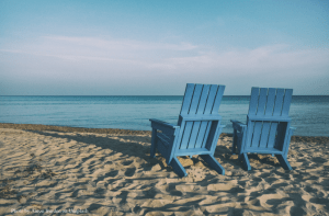 empty chairs on beach representing exit planning