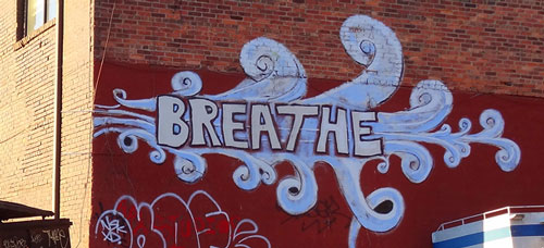 graffitti saying breathe