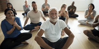 group of happy meditators