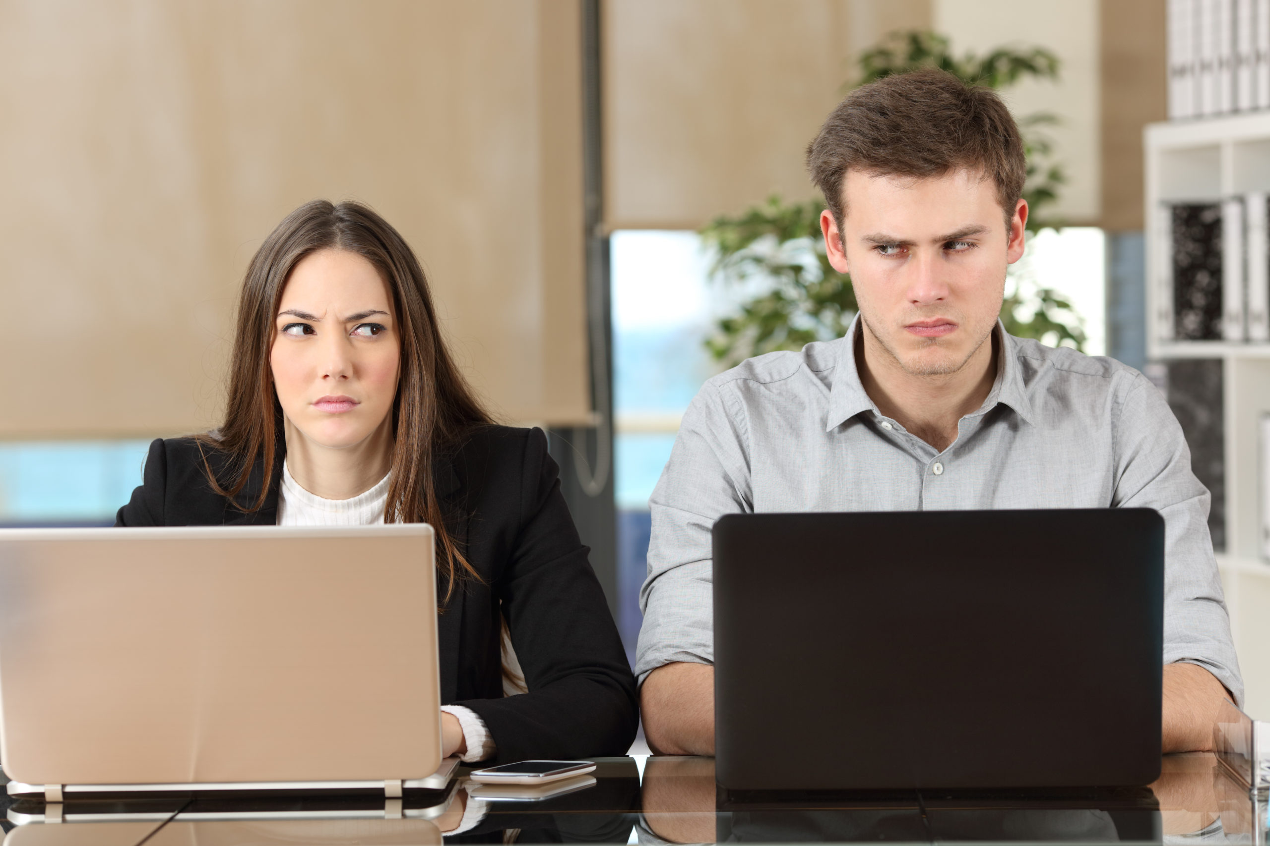 A couple glaring at each other - Dhillon Law Group