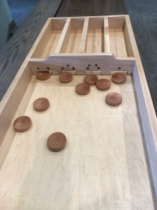 A great family game for all ages! This Dutch shuffleboard game is great for family get-togethers and is hand-made by Casey Kuperus, who grew up playing this game with his parents.
